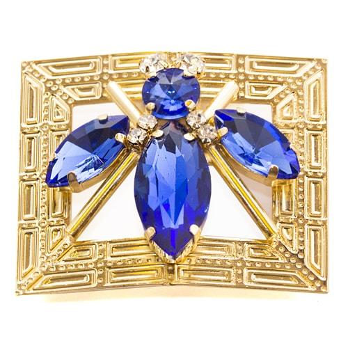 Applicazione dorata con insetto blu