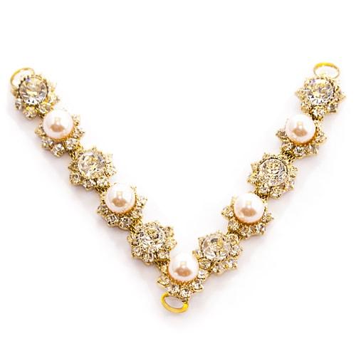 Morsetto dorato con perle bianche