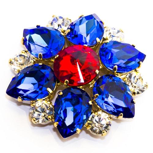 Applicazione con pietre in vetro blu e rosse