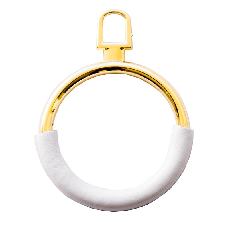Applicazione dorata circolare rivestita in pelle bianca